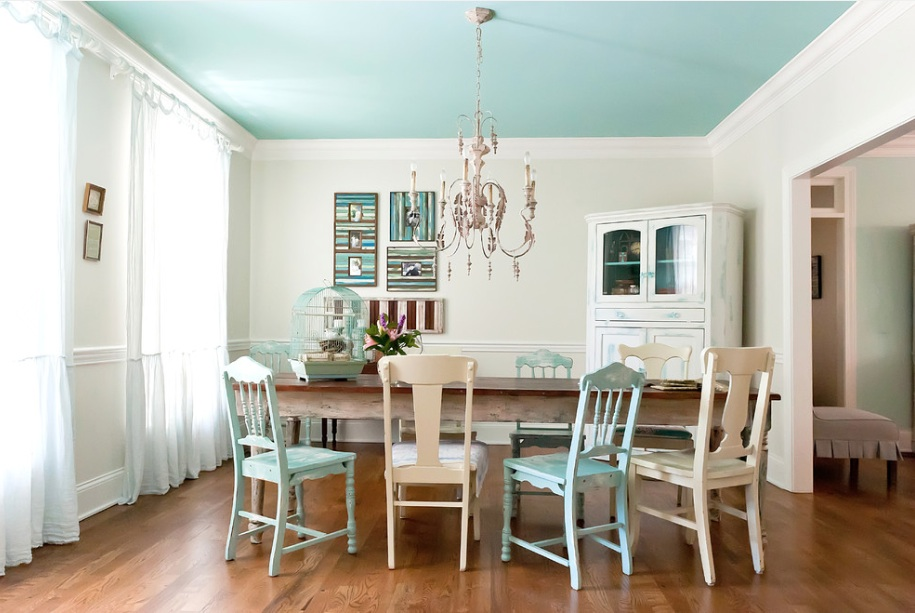 Dining room with turquoise ceiling.