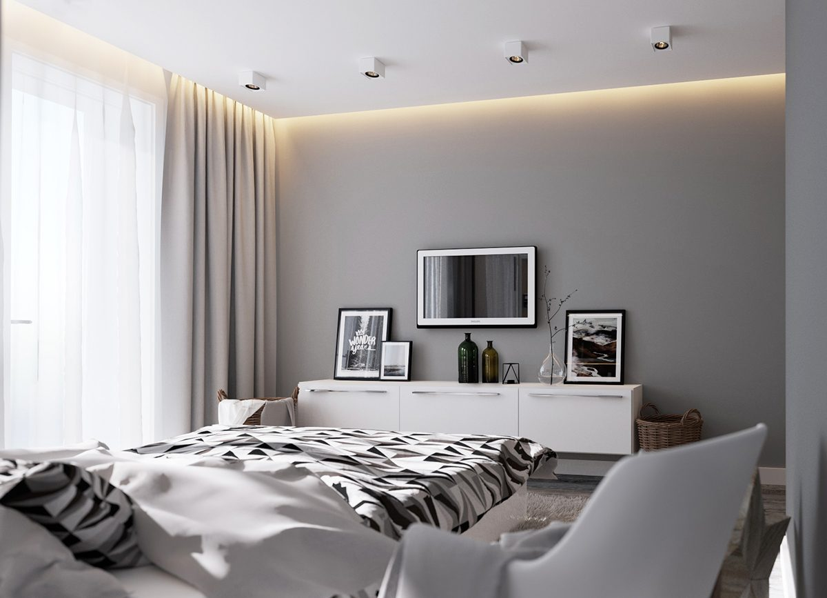 A bed room with monochromatic colour palette.