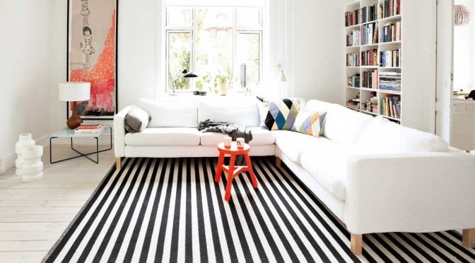 Living Room floor with stripe rug.