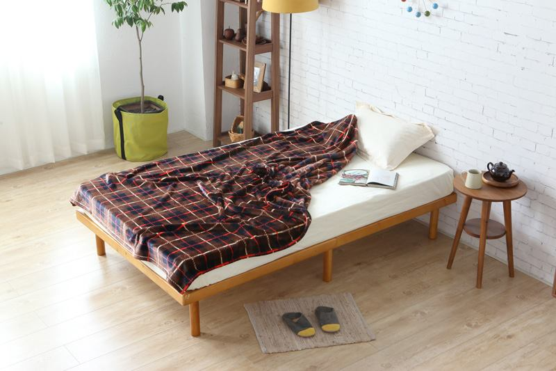 Cuenca wooden bed frame in a bedroom, good for maximising small spaces.