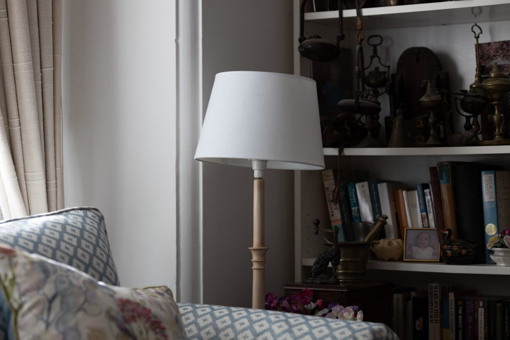 A floor lamp takes up unnecessary storage space in your bedroom.