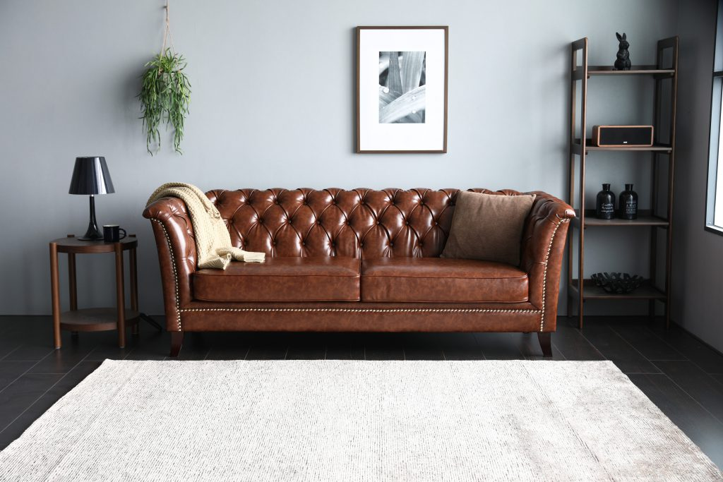 Neil Chesterfield Sofa in PU Leather in a living room.